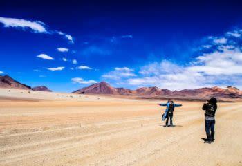 Travelers take photo in South America desert