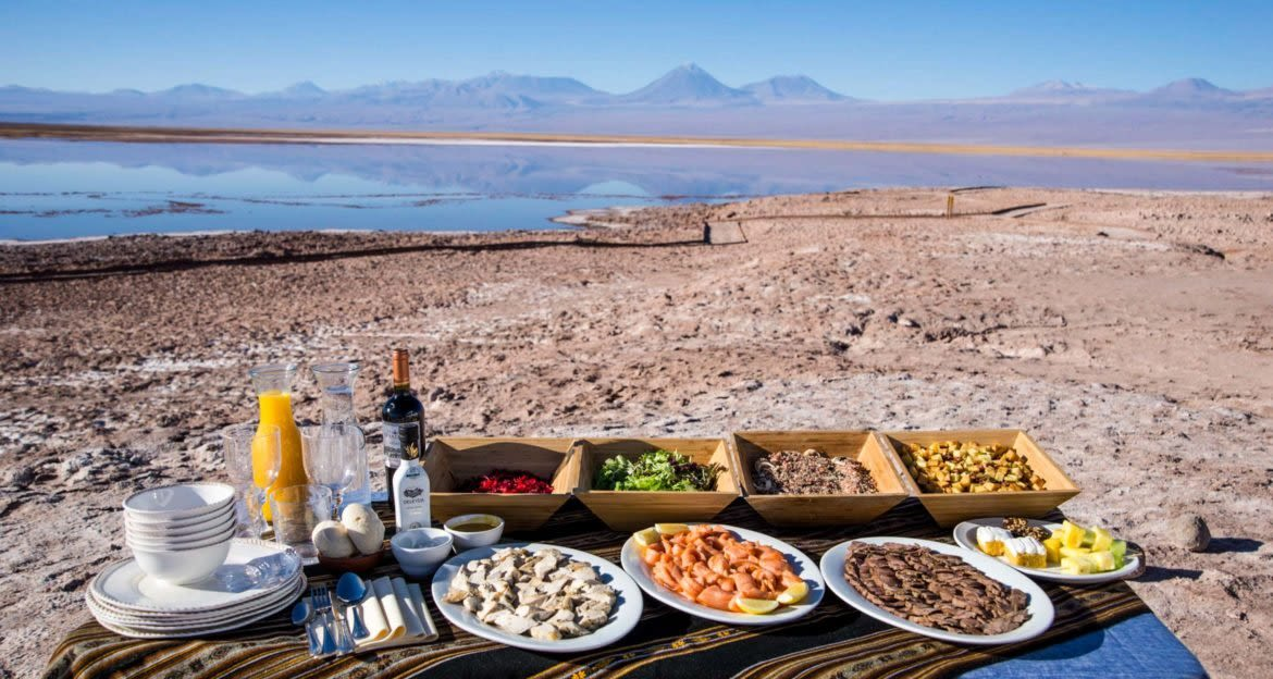 Picnic laid out in desert near mountains