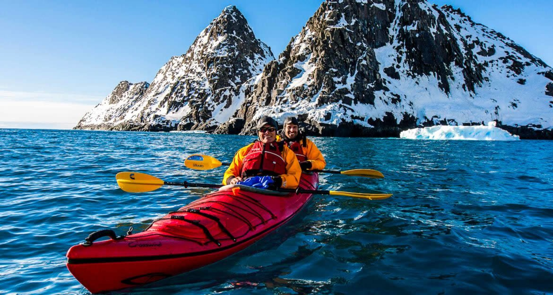 Travelers use double kayak in Antarctica waters