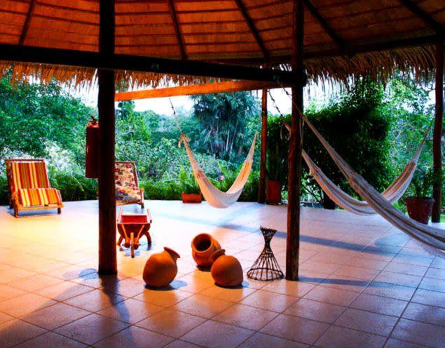 Hammocks on outdoor patio of Eco Park Lodge