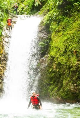 Travelers explore Ecuador waterfall