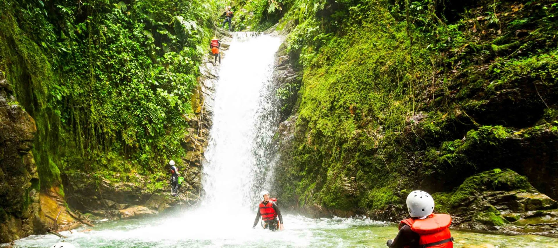 Travelers explore Ecuador waterfall
