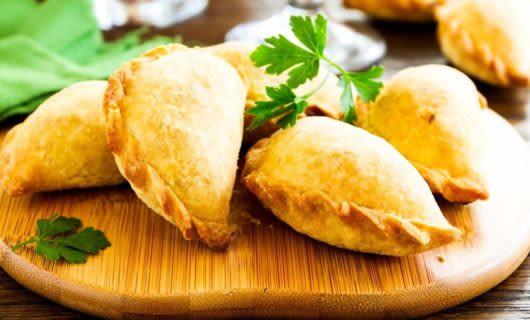 Empanadas on wooden platter