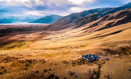 Aerial view of Eolo Lodge and surrounding valley