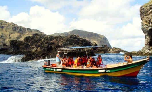 Travelers take fishing boat trip around Easter Island