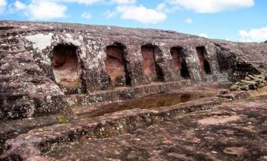 Five niches in rock of El Fuerte archeological site, Bolivia