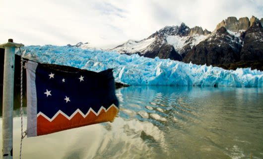 Flag in front of Patagonia glacier