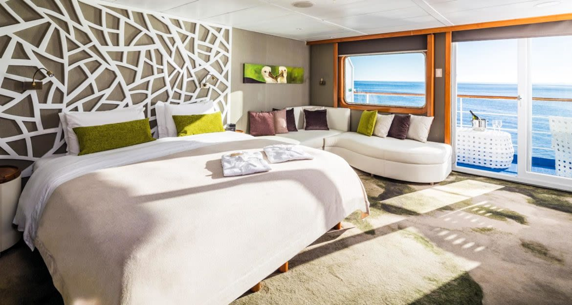 Bedroom in suite of Galapagos cruise ship