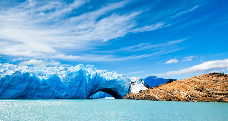 Arch in glacier near shore