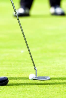 Man putts on golf green