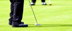 Man putts on golf green