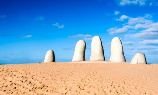 Sculpture of hand in the desert