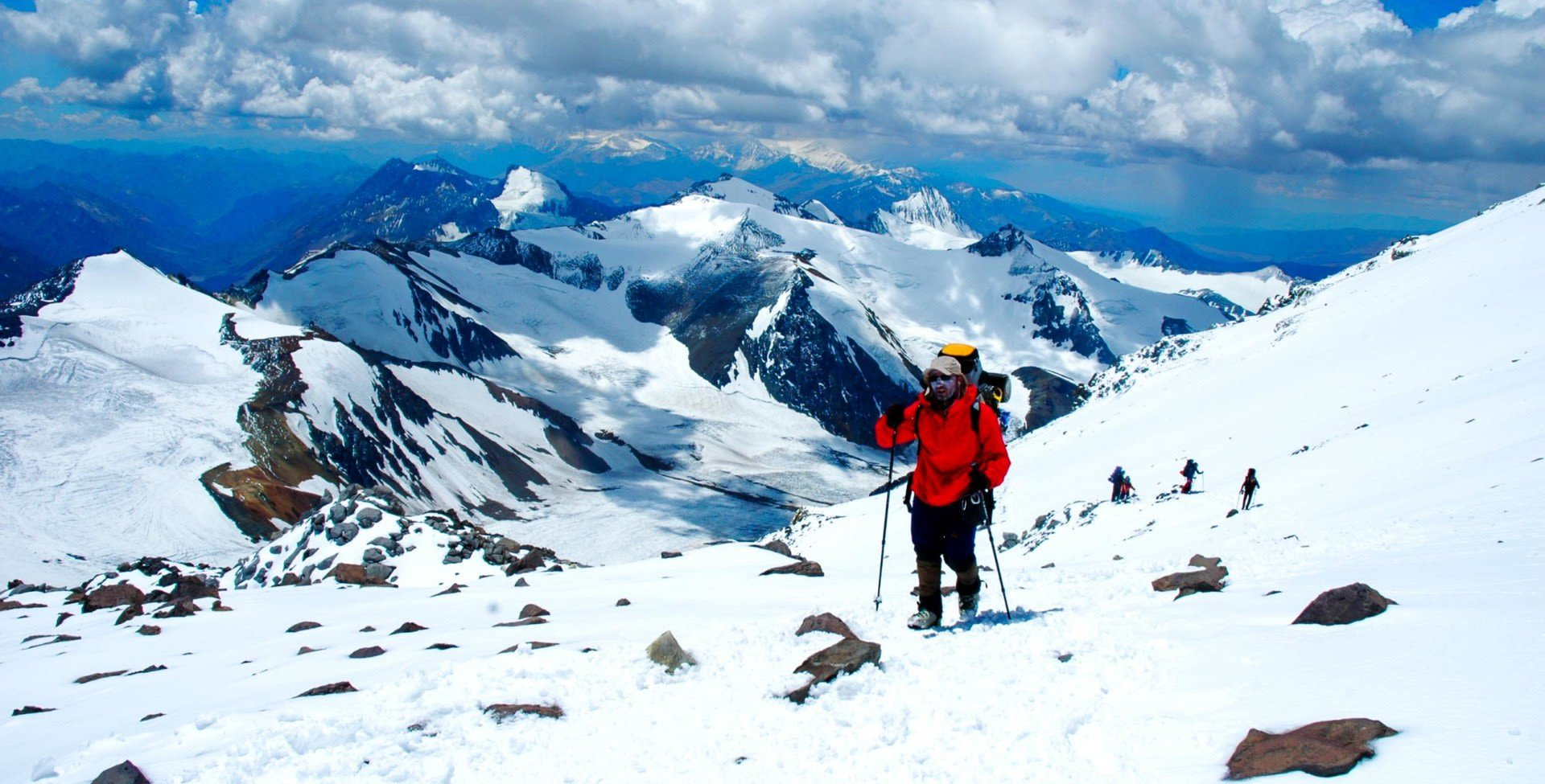 Hiker traverses snowy South America mountains