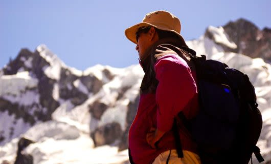 Low angle of hiker standing in South America mountains