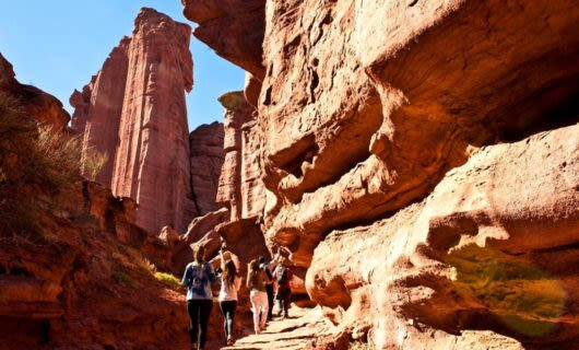 Group of hikers on canyon trail