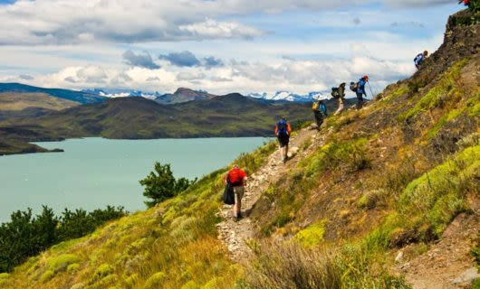 Group hikers up hillside in South America