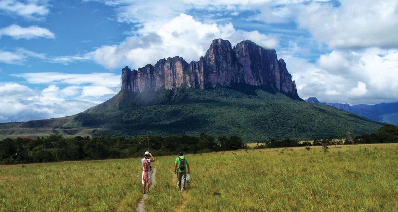 Two hikers near Mount Roraima in Venezuela