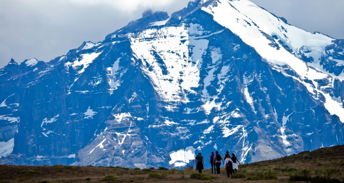 Hiking group in front of large mountain