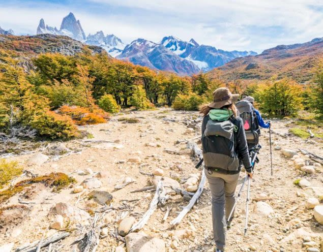 Hikers trek toward Torres del Paine mountains