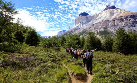Hiking group treks through French Valley in South America