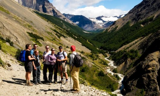 Hiking group pauses at end of valley