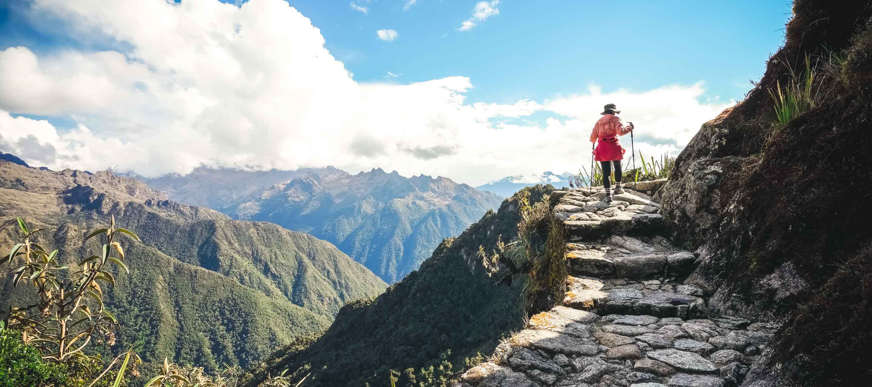Person hiking cliffside section of Inca Trail