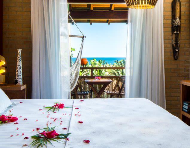 Rose petals on bed in honeymoon suite