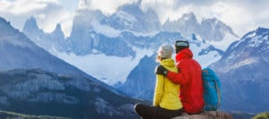Couple admiring the mountains in Patagonia