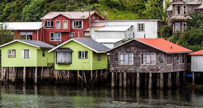 Houses on stilts on coast of island
