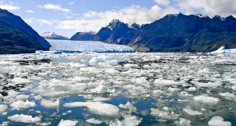 Broken up glacial ice near mountains