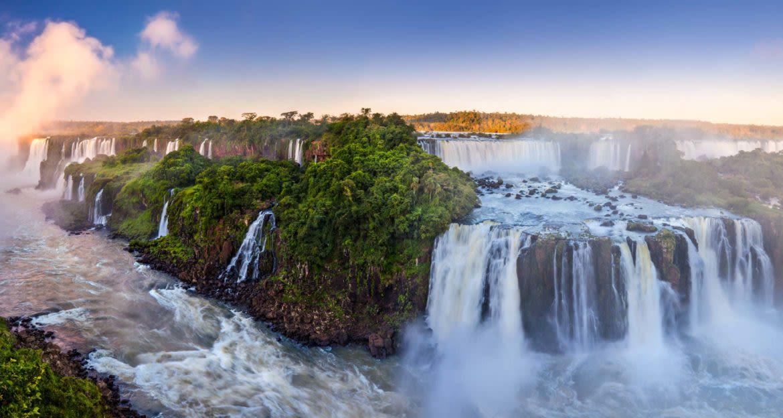 Panoramic view of Iguazu Falls at sunset