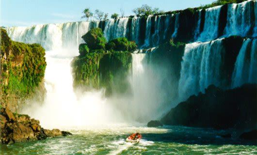 Tour boat approaches base of Iguazu Falls