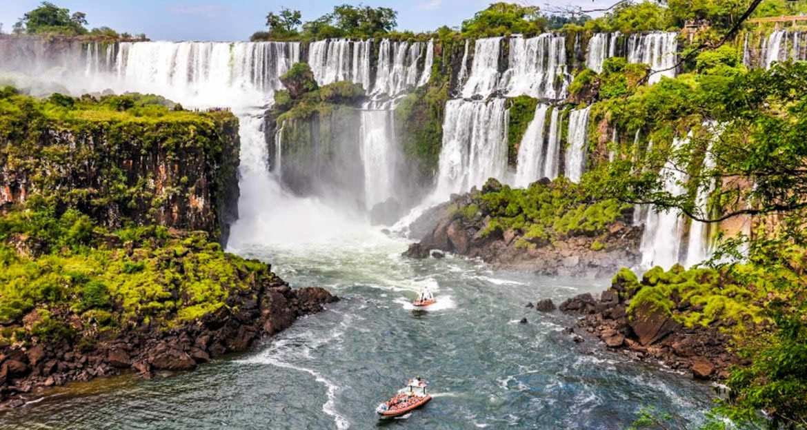 Two boats approach base of Iguazu Falls