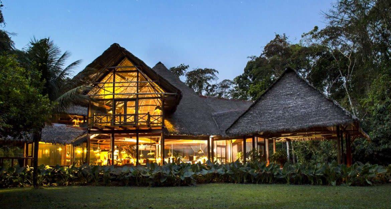 Inkaterra Reserva Amazonica lodge exterior at evening
