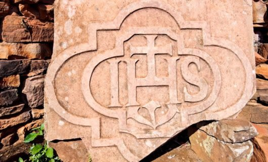Jesuit symbol on red rock