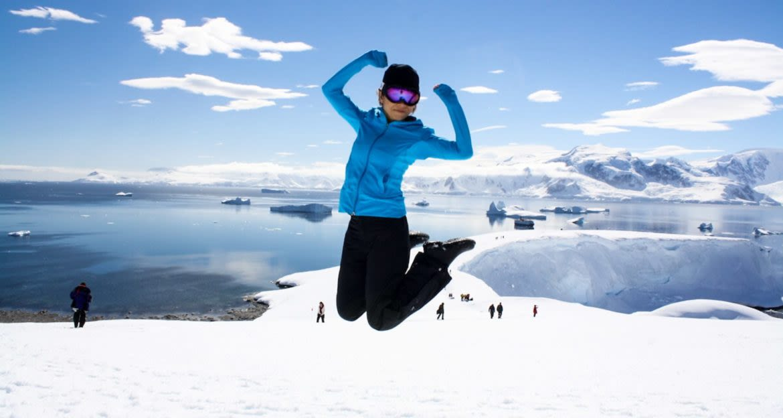 Woman in mid-jump in Antarctica