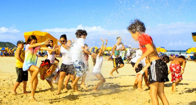 Kids play on beach in Brazil