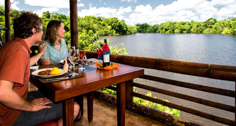 Travelers enjoy lunch on deck of La Selva Amazon Lodge