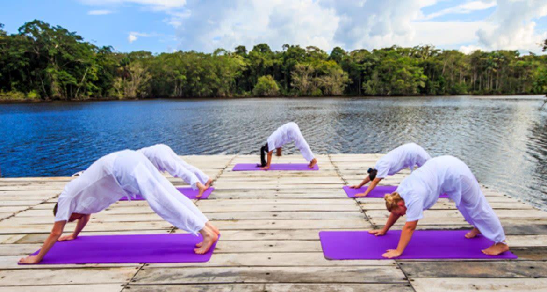 Yoga class on outdoor deck of La Selva Amazon Lodge