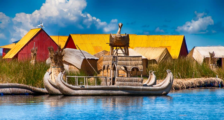 Straw Lake Titicaca boat sits near village