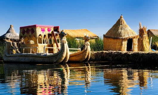 Canoes and huts on Lake Titicaca