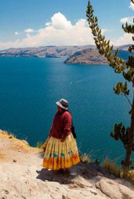 Two women stand near Lake Titicaca