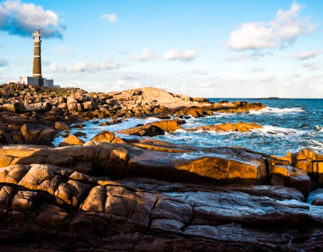 Lighthouse on rocky beach