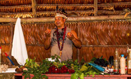 Man prepares food in lodge