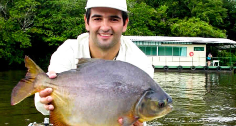 Man holds fish in Brazil Pantanal