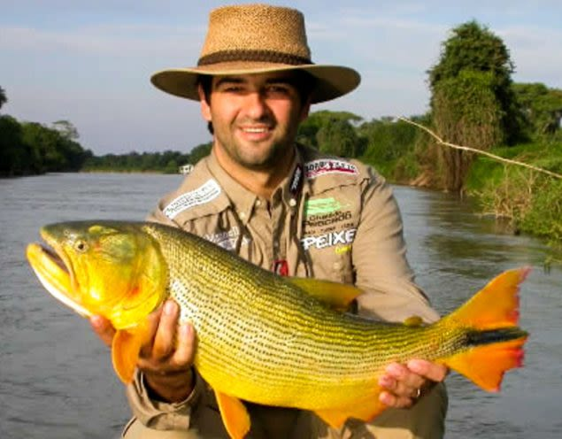 Man holds fish in Brazil Pantanal