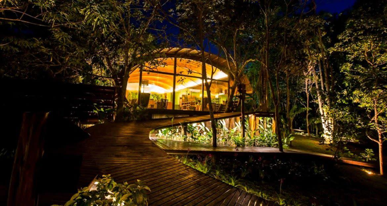 Exterior of Mirante do Gavião Amazon Lodge at night