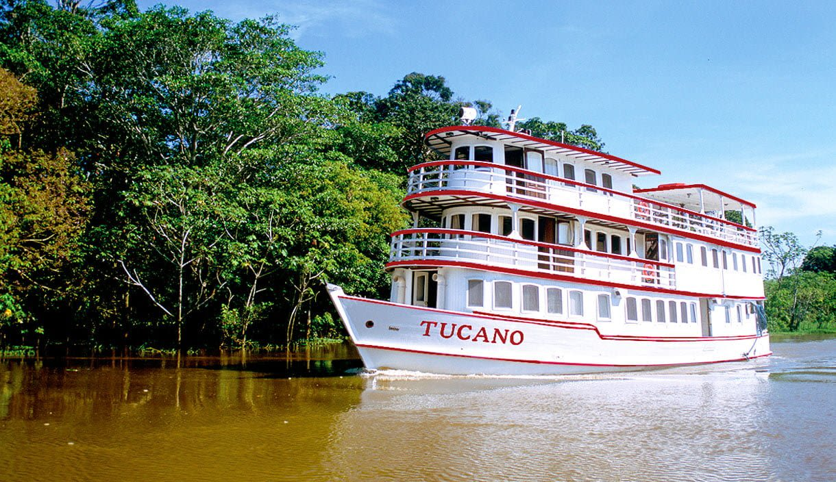 Motor yacht travels down South America river