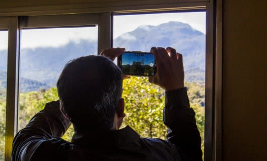 Man takes picture of mountain through phone