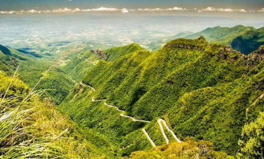 Aerial view of winding road through mountains